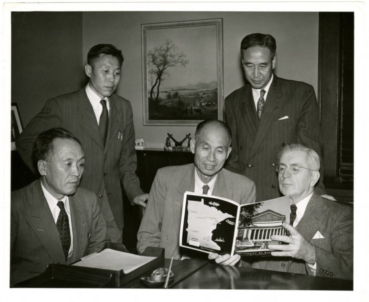 This photograph features Dr. Harold Macy showing a University of Minnesota pamphlet to SNU faculty including, Dr. Park, Ministry of Education, Mr. Lee, Professor of the College of Agriculture, Dr. Choi, President of SNU, and Mr. Kim, Principal of Seoul High School. Source: University of Minnesota Archives, Photograph Collection.