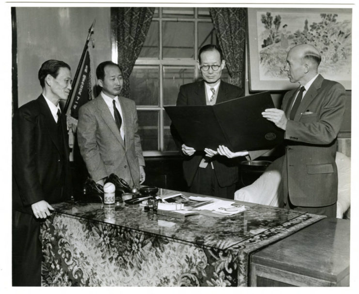 This photograph features Joong Whi Kwon, Dean of Students, Chong Soo Lee, Academic Dean and Vice President Il Sun Yun receiving greetings from. Dr. A. E. Schneider, of the University of Minnesota and Chief Adviser in Korea for the SNU cooperative project, in 1955. Source: University of Minnesota Archives, Arthur E. Schneider Papers (uarc 1142)