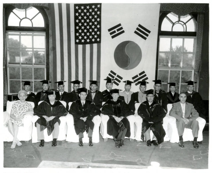 A photograph of the ceremony for the conferment of an Honorary Doctorate (Law) on the Honorable Arthur E. Schneider. The date is unknown. Source: University of Minnesota Archives, Photograph Collection.