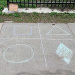 Chalk drawing of math on a sidewalk