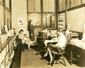 Sepia toned photograph circa 1925 of a group of women in an office
