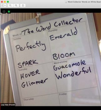 Whiteboard with words like spark and bloom and glimmer hand written in black markere
