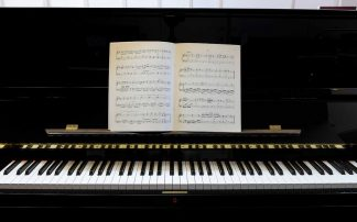 Piano with classical music score