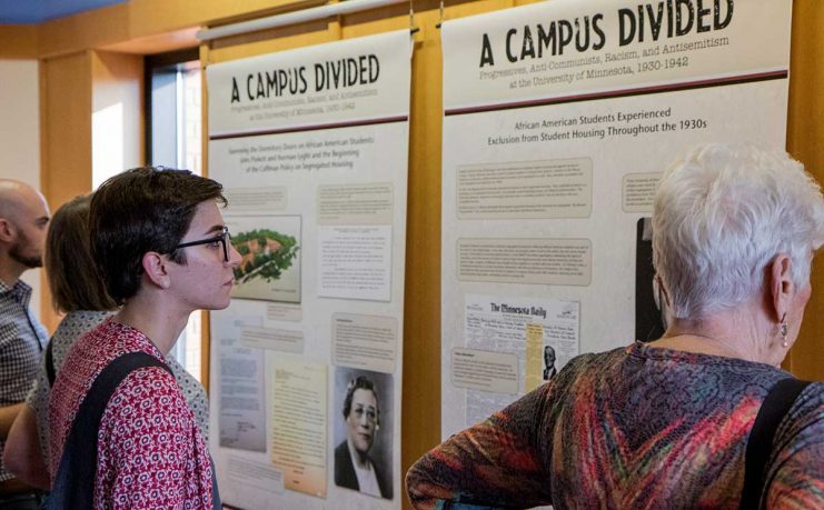 People viewing the Campus Divided exhibit