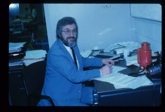 Bill DeJohn at his desk during his first year as Minitex Director in Wilson Library.