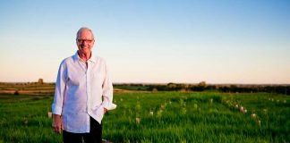 Dewey Thorbeck standing in a field