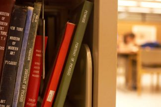 Books on the stacks in Wilson Library