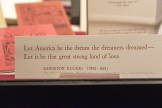"""Card showing Langston Hughes quote, """"Let American be the dream the dreamers dreamed — Let it be that great strong land of love"""""""