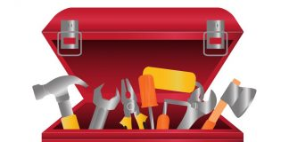 Red toolbox with lid open and filled with tools